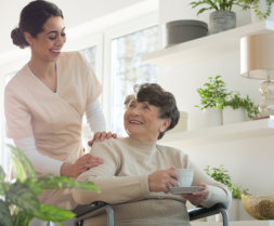 caregiver gives coffee to her patient